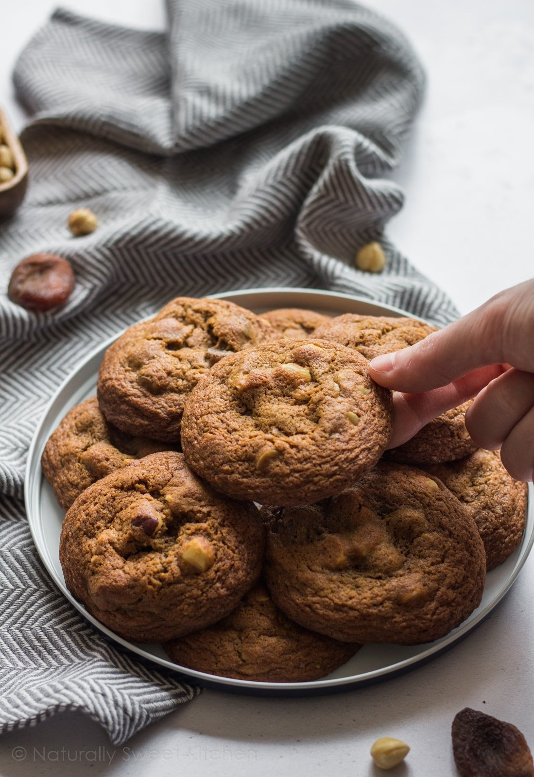 These Apricot and Hazelnut Cookies are a dried fruit and nut lover's dream – a delightfully chewy cookie popping with tart apricots, roasted hazelnuts, and a hint of spice. | Naturally Sweet Kitchen | Chewy Cookie | Hazelnut Cookie | Dried Apricots