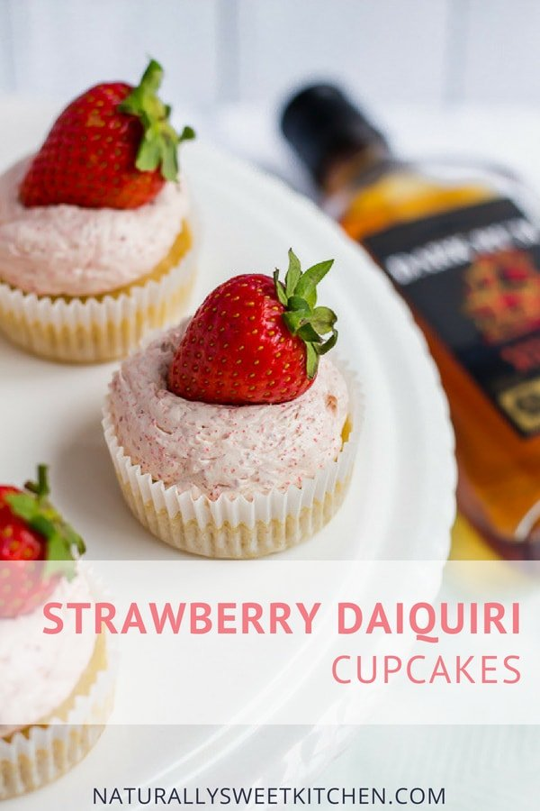Boozy summertime cupcakes made with vanilla rum cupcakes, strawberry swiss meringue buttercream, and a tangy lime curd. | Naturally Sweet Kitchen | Strawberry daiquiri | Strawberry buttercream recipe | Rum cake #strawberry #rum