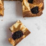 Studded with sweet blackberries and a swirl of tangy cheesecake, these soft and chewy Blackberry Cheesecake Bars will be your go-to end of summer treat. Get this recipe and more refined sugar free desserts at naturallysweetkitchen.com | Naturally Sweet Kitchen | blackberry dessert | cheesecake bars | blackberry recipes #blackberry #refinedsugarfree