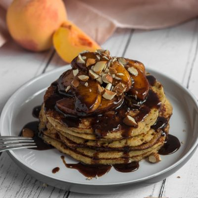 Delicate, wholesome, and packed with autumn flavours, these Almond Pancakes with Spiced Peach Syrup will be your new favourite Sunday brunch recipe. #naturallysweetkitchen #almondpancakes #brunchrecipe #pancakerecipe