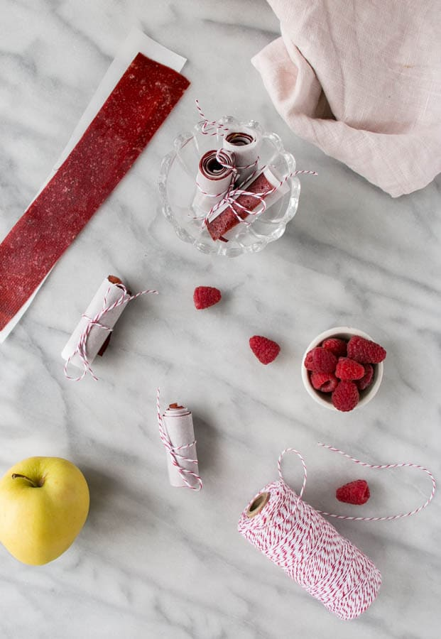 Homemade Fruit Leather and 16 other refined sugar free snacks recipes. Perfect for school snacks, post work out snacks, or whenever you need an easy snack! Get the recipe round-up on naturallysweetkitchen.com #schoolsnacks #healthysnacks #naturallysweetkitchen #preworkoutsnacks #refinedsugarfree
