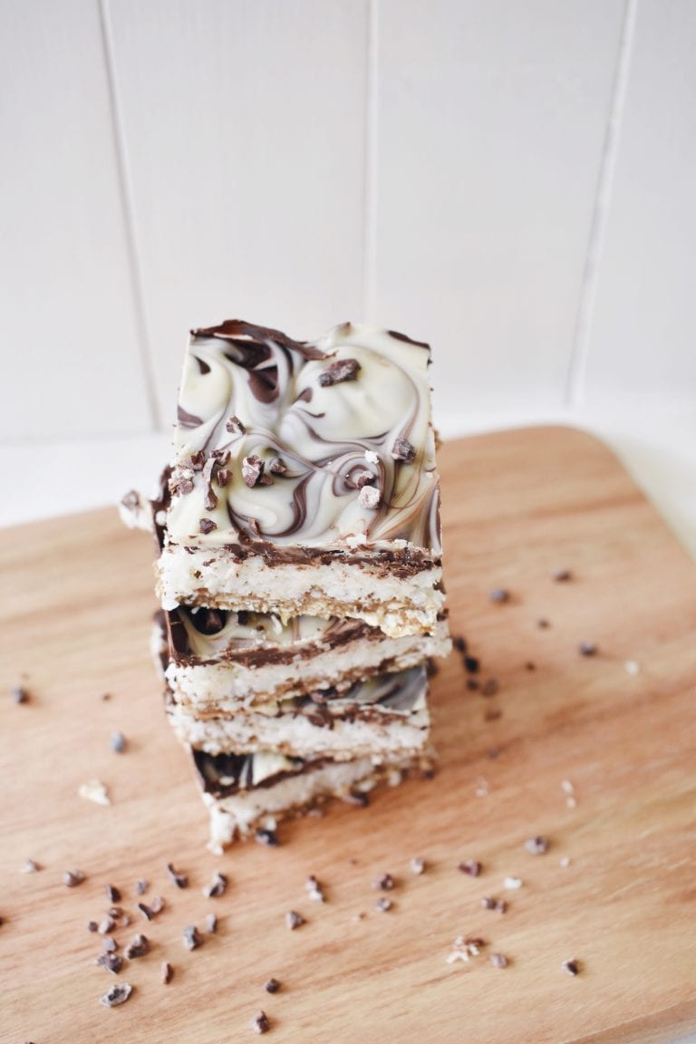 Vegan Coconut Slice and 16 other refined sugar free snacks recipes. Perfect for school snacks, post work out snacks, or whenever you need an easy snack! Get the recipe round-up on naturallysweetkitchen.com #schoolsnacks #healthysnacks #naturallysweetkitchen #preworkoutsnacks #refinedsugarfree