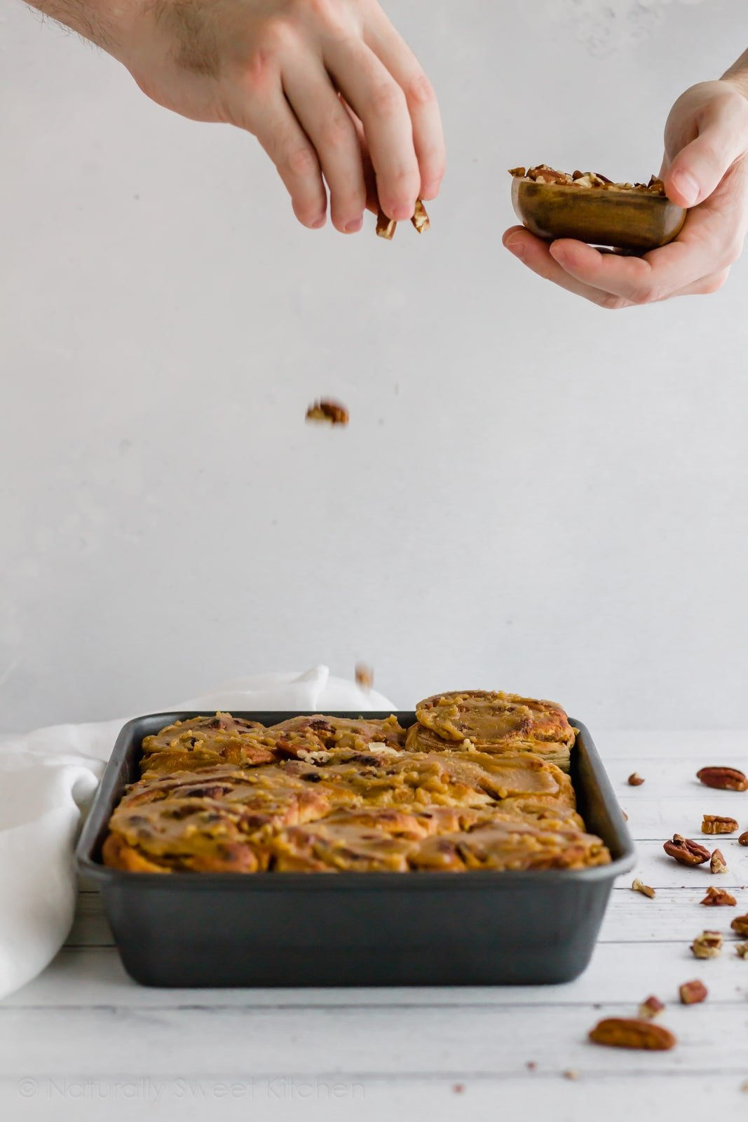 Easy pecan pumpkin cinnamon rolls! The best fall baking recipe for brunch, snack, or dessert. Top with a quick, sugar-free caramel sauce for that little bit extra. Get the recipe and more refined sugar free desserts at naturallysweetkitchen.com #naturallysweetkitchen #sugarfree #pumpkin #cinnamonrolls #pecans #caramelsauce