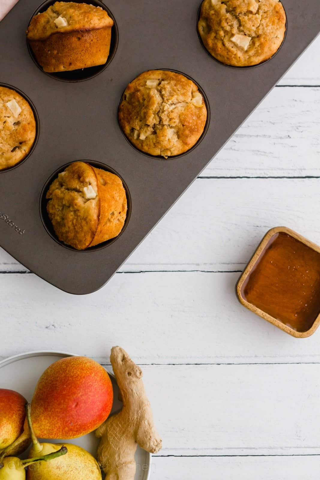 These ginger pear muffins are an quick and easy on-the-go breakfast. Packed with fresh fruit and fibre, this muffin recipe will keep you going through to lunch. Get the recipe and more refined sugar free desserts at naturallysweetkitchen.com #naturallysweetkitchen #refinedsugarfree #muffins #easyrecipe #breakfast