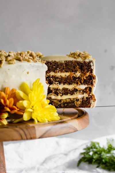 This healthy carrot cake recipe is naturally sweetened with coconut sugar and maple syrup and features a smooth heritage cream cheese frosting. Perfect for Easter baking! Get the recipe at naturallysweetkitchen.com. #naturallysweetkitchen #refinedsugarfree #carrotcake #easter #baking #sugarfree