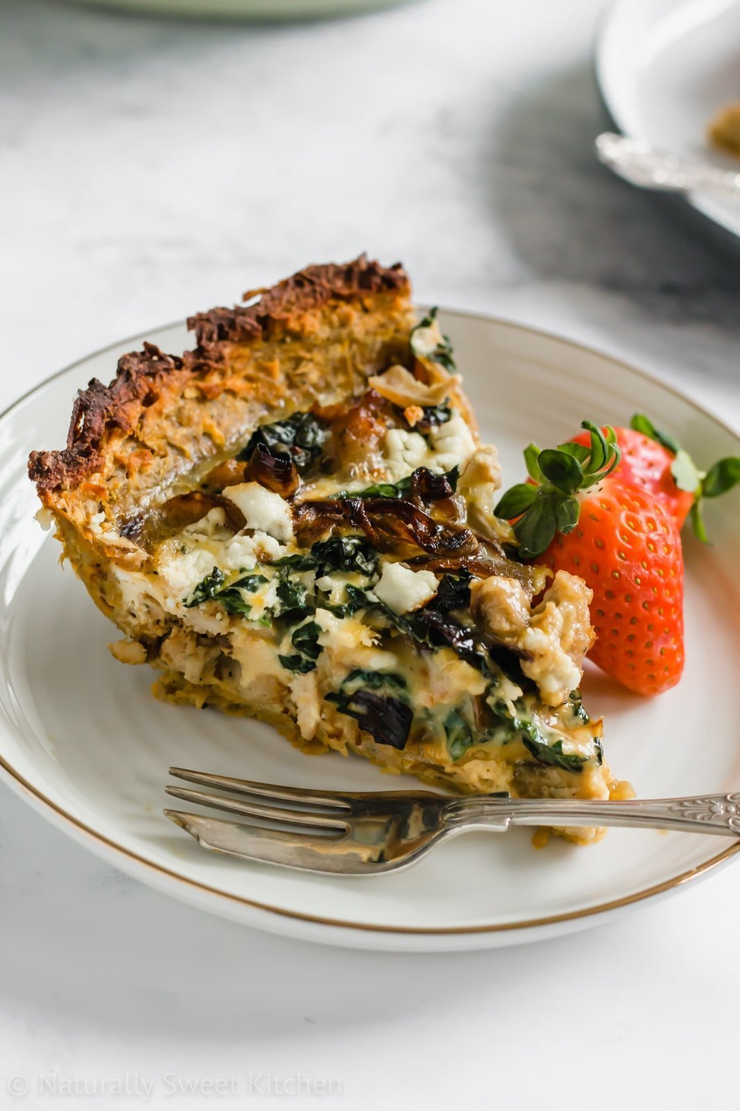 This easy quiche recipe is perfect for a special brunch and features a healthier alternative: a sweet potato crust! Paired with sausage, kale, goat cheese, caramelized onions, this is one sweet potato crust quiche recipe you'll want to make again and again. Get this recipe and other refined sugar free recipes at naturallysweetkitchen.com #brunch #breakfast #brunchrecipe #eggrecipe #naturallysweetkitchen #sugarfree #caramelizedonions #kale #sweetpotato #baking