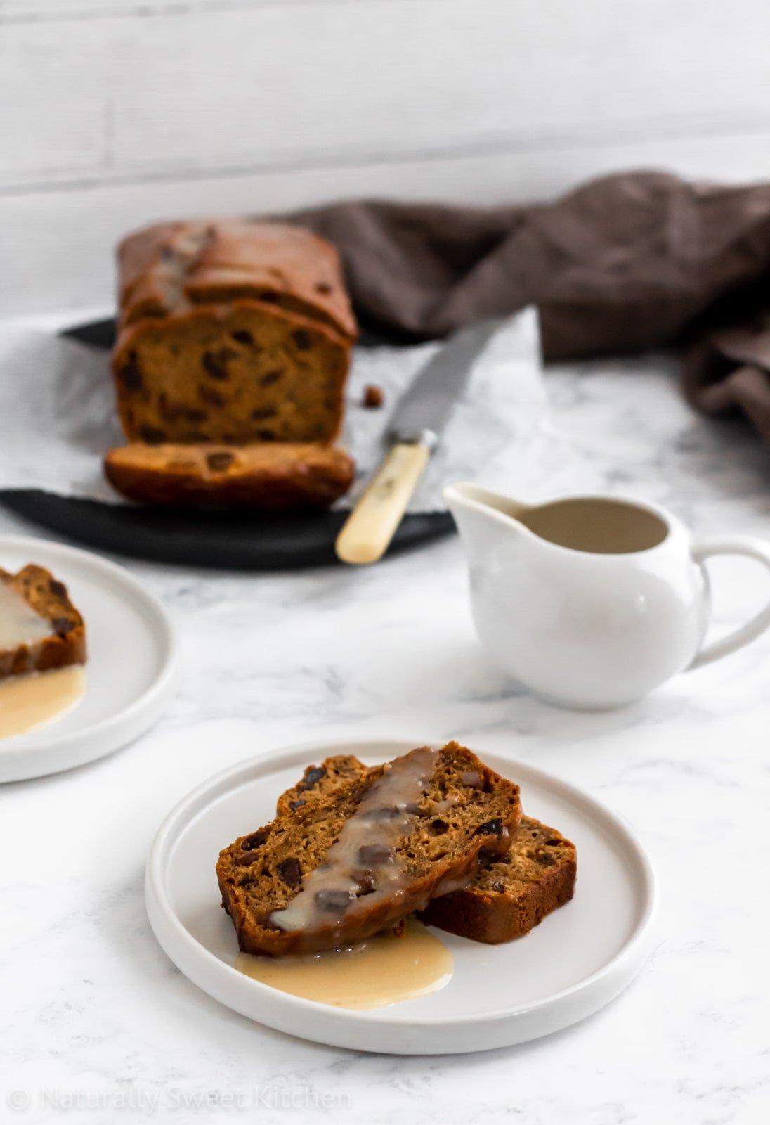 Rum and raisin banana bread topped with a sugar-free vanilla glaze.
