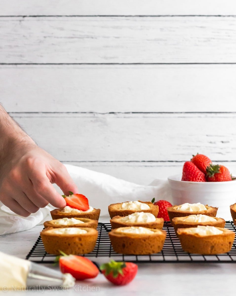 This refined sugar free strawberry shortcake cookie cups recipe is made with fresh strawberries, naturally sweetened whipped cream, and chewy sugar cookies.