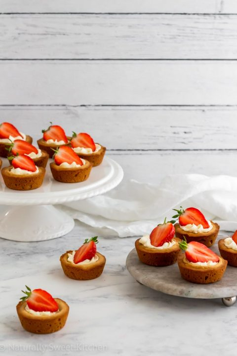 Refined sugar free sugar cookies, homemade whipped cream, and fresh strawberries come together in this strawberry shortcake cookie cups recipe.