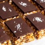 flakey sea salt topped sugar free chocolate dessert bars cut into rows