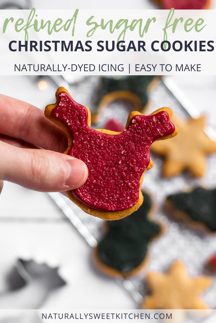 These Christmas sugar cookies are naturally sweetened with agave syrup and frosted with the best naturally dyed icing! Easy to make and perfect for family-friendly decorating this holiday baking season. Get the recipe on naturallysweetkitchen.com.