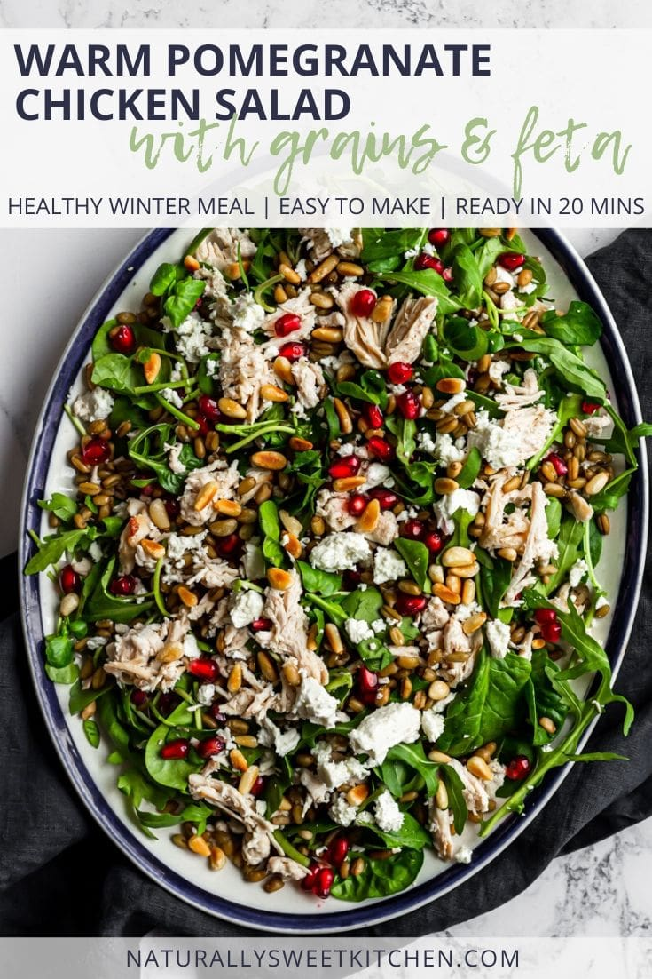 This delicious winter salad recipe features warm chicken and grains, creamy salty feta cheese, pops of juicy pomegranate, and nutty toasted pine nuts! It's the perfect healthy dinner recipe for the long, cold season! Get the recipe on naturallysweetkitchen.com