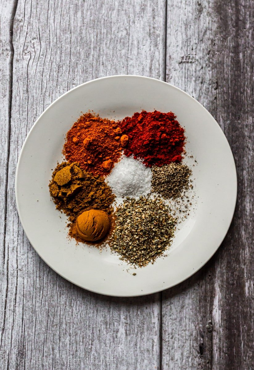 seven spices needed to to flavour smoky instant pot vegan chili on a white plate