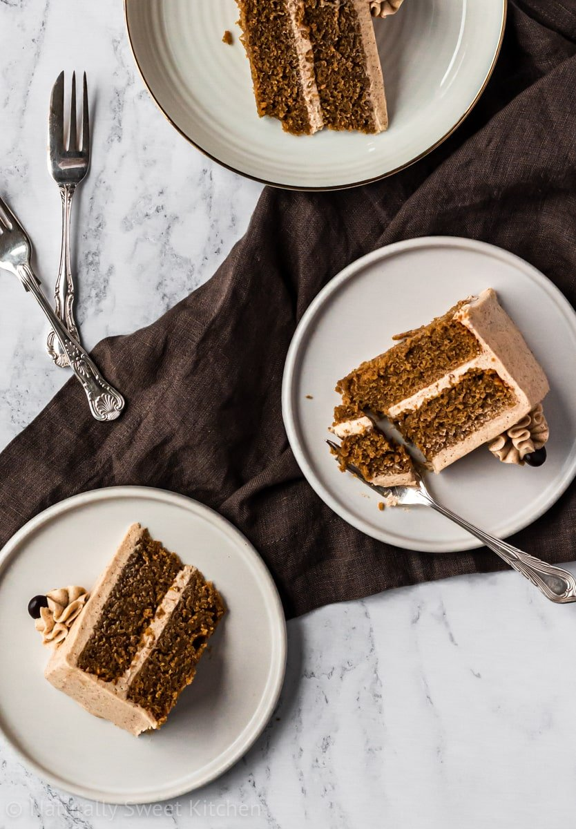 three plates of an easy coffee cake recipe with a brown napkin and cake forks in the background