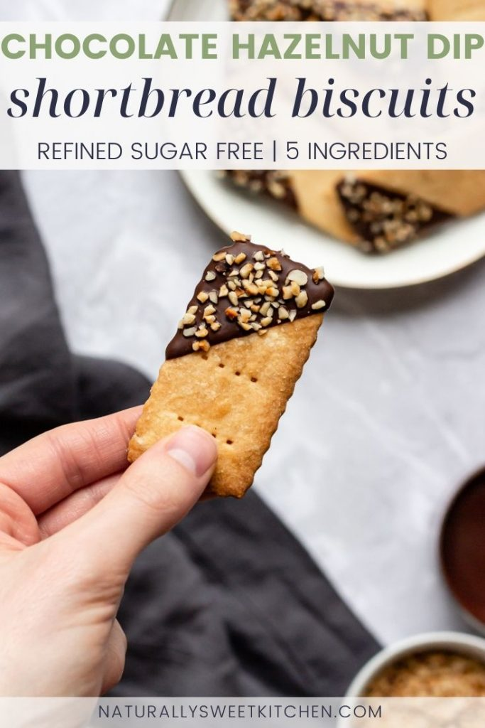 These crispy and crumbly shortbread biscuits are refined sugar free and only require 5 staple ingredients! A dark chocolate dip and sprinkle of roasted hazelnuts makes these biscuits holiday baking ready. Grab the full recipe on naturallysweetkitchen.com via @naturallysweetkitchen.