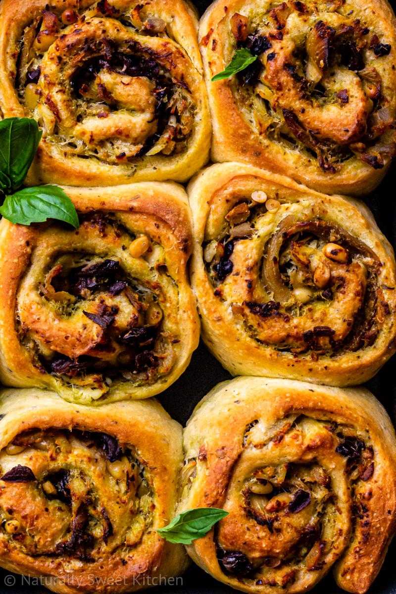 a close up of the swirls of pesto chicken rolls