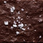 a close up shot of the texture of some refined sugar free brownies topped with sea salt